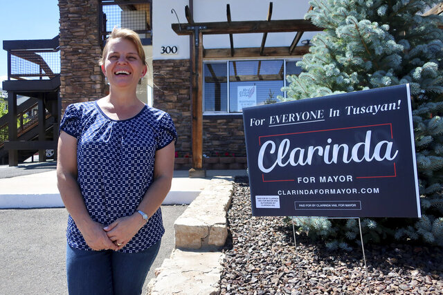 This Tuesday, July 28, 2020 photo shows mayoral candidate Clarinda Vail outside the lodge she manages in Tusayan, Ariz. About 240 residents of Tusayan are registered to vote in the primary election that will decide the mayoral race Tuesday, Aug. 4, 2020. (AP Photo/Felicia Fonseca)