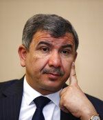 CORRECTS SPELLING TO ISMAIL FROM ISMAEL - Ihsan Abdul-Jabbar Ismail, Iraq Oil minister speaks during an interview with The Associated Press in Baghdad, Iraq, Friday, June 11, 2021. Iraq's oil sector is rebounding after a catastrophic year triggered by the coronavirus pandemic with key investment projects on the horizon, but the country's oil minister warned an enduring bureaucratic culture of fear threatens to stand in the way. (AP Photo/Hadi Mizban).