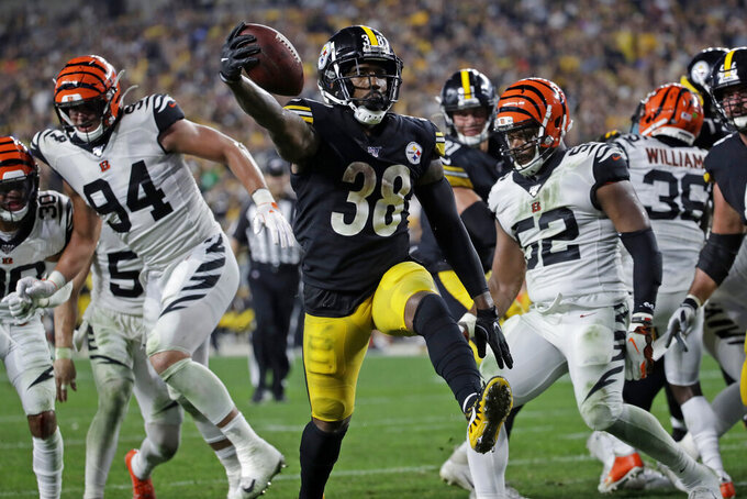 Pittsburgh Steelers running back Jaylen Samuels (38) scores on a 2-yard run during the second half of an NFL football game against the Cincinnati Bengals in Pittsburgh, Monday, Sept. 30, 2019. (AP Photo/Don Wright)