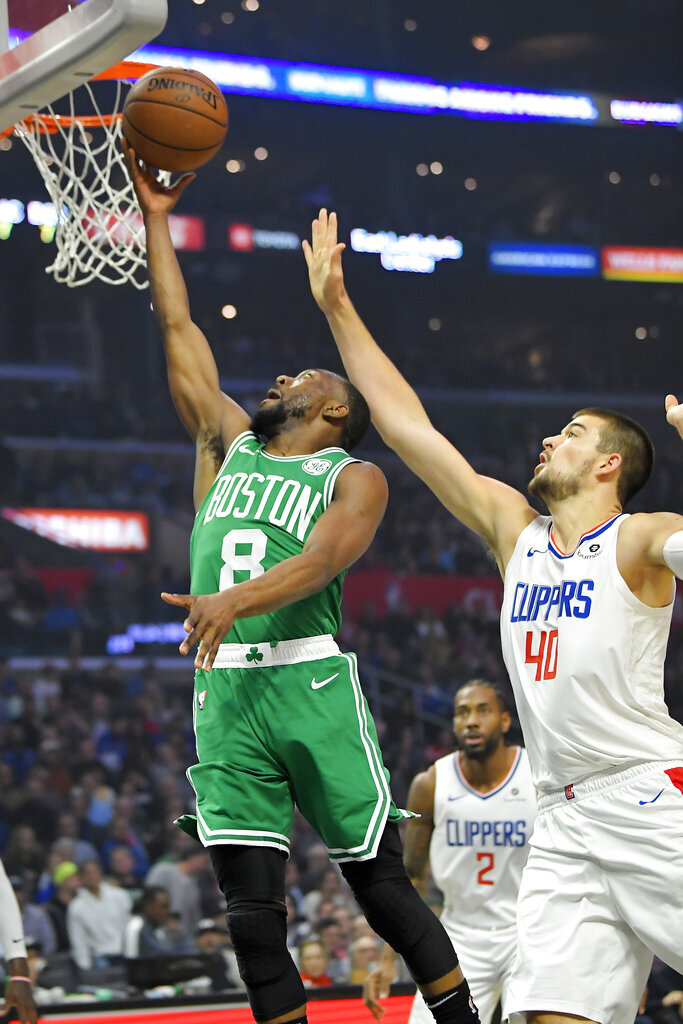Boston Celtics guard Kemba Walker, left, shoots as Los Angeles Clippers center Ivica Zubac defends during the first half of an NBA basketball game Wednesday, Nov. 20, 2019, in Los Angeles. (AP Photo/Mark J. Terrill)