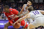 Ohio State forward E.J. Liddell, left, drives to the basket against Northwestern guard Boo Buie and forward Miller Kopp (10) during the first half of an NCAA college basketball game in Evanston, Ill., Sunday, Jan. 26, 2020. (AP Photo/Nam Y. Huh)