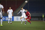 In this photo provided by the Korea Football Association, South Korea's Kim Jin-su fights for the ball against North Korea's Pak Kwang Ryong, right, during their Asian zone Group H qualifying soccer match for the 2022 World Cup at Kim Il Sung Stadium in Pyongyang, North Korea, Tuesday, Oct. 15, 2019. (The Korea Football Association via AP)