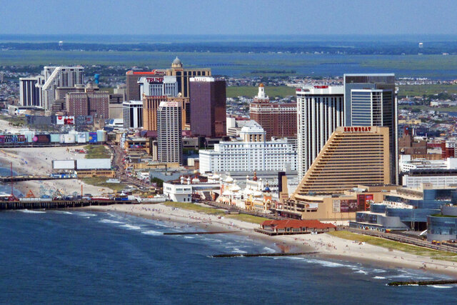 This July 11, 2014 aerial photo shows the shoreline in Atlantic City, N.J. The city's voters will decide on May 12, 2020, whether to eliminate an elected mayor in favor of an appointed city manager. (AP Photo/Wayne Parry)