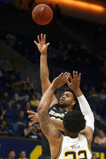 Colorado forward Evan Battey (21) lofts a shot over California forward Andre Kelly (22) during the first half of an NCAA college basketball game Thursday, Feb. 27, 2020, in Berkeley, Calif. (AP Photo/D. Ross Cameron)