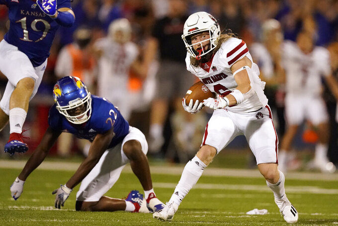 South Dakota wide receiver Kody Case gets past Kansas cornerback Duece Mayberry (22) to run for a first down during the second half of an NCAA college football game Friday, Sept. 3, 2021, in Lawrence, Kan. Kansas won 17-14. (AP Photo/Charlie Riedel)