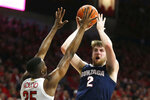 Gonzaga forward Drew Timme (2) shoots over Arizona center Christian Koloko in the first half of an NCAA college basketball game, Saturday, Dec. 14, 2019, in Tucson, Ariz. (AP Photo/Rick Scuteri)