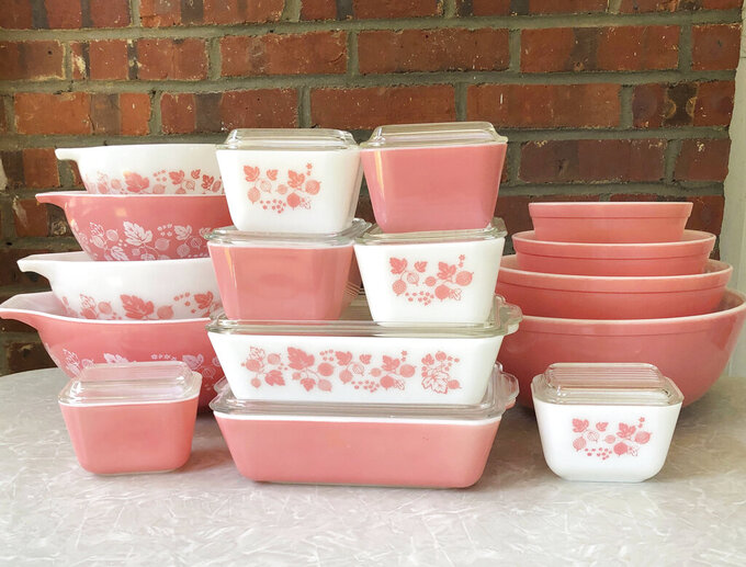 "Vintage pieces of Pyrex sets, including ""Cinderella"" bowls and refrigerator dishes in the Pink Gooseberry pattern, manufactured in the 1950s and 1960s, appear in a kitchen cupboard. Vintage kitchenware is back in style. Some collectors buy vintage dishware to try to resell it at a profit, while others are in it for nostalgia. (Lauren McCullough via AP)"