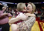 Missouri State coach Kellie Harper, right, celebrates the team's 69-60 win over Iowa State with her 5-year-old son, Jackson Harper, after a second-round game in the NCAA women's college basketball tournament Monday, March 25, 2019, in Ames, Iowa. (AP Photo/Matthew Putney)