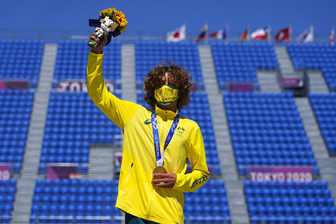 Gold medal winner Keegan Palmer of Australia poses for photos after the men's park skateboarding finals at the 2020 Summer Olympics, Thursday, Aug. 5, 2021, in Tokyo, Japan. (AP Photo/Ben Curtis)