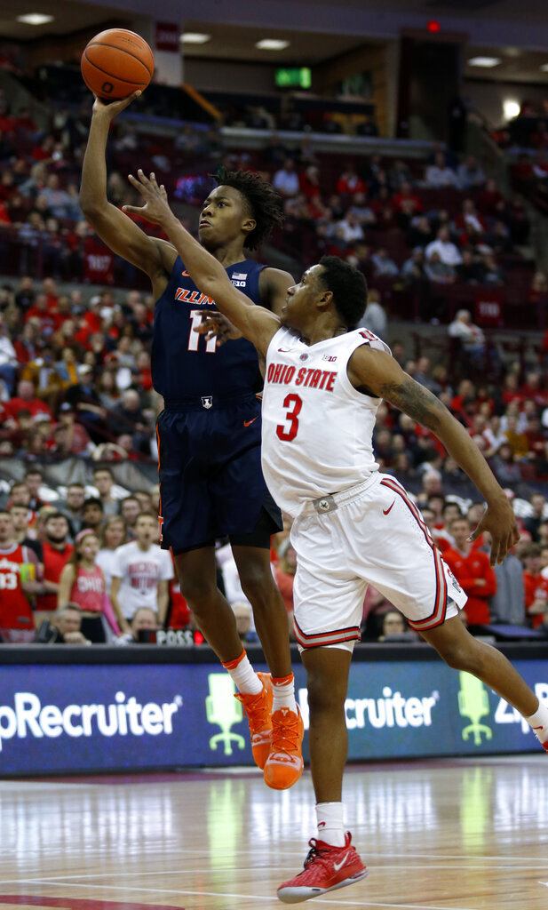 Illinois guard Ayo Dosunmu shoots next to Ohio State guard C.J. Jackson during the first half of an NCAA college basketball game in Columbus, Ohio, Thursday, Feb. 14, 2019. (AP Photo/Paul Vernon)