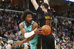 Memphis Grizzlies forward Solomon Hill (44) passes the ball as Cleveland Cavaliers forward Larry Nance Jr. (22) defends during the first half of an NBA basketball game Friday, Jan. 17, 2020, in Memphis, Tenn. (AP Photo/Karen Pulfer Focht)