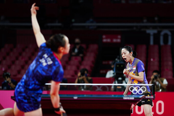 Singapore's Yu Mengyu, right, gestures during the bronze medal match of the table tennis women's singles against Japan's Mima Ito at the 2020 Summer Olympics, Thursday, July 29, 2021, in Tokyo. (AP Photo/David Goldman)