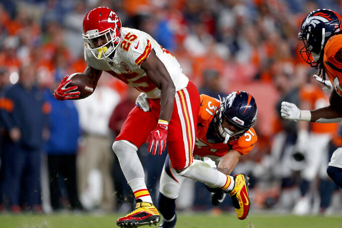 Kansas City Chiefs running back LeSean McCoy (25) is hit by Denver Broncos inside linebacker Todd Davis (51) during the second half of an NFL football game, Thursday, Oct. 17, 2019, in Denver. (AP Photo/David Zalubowski)