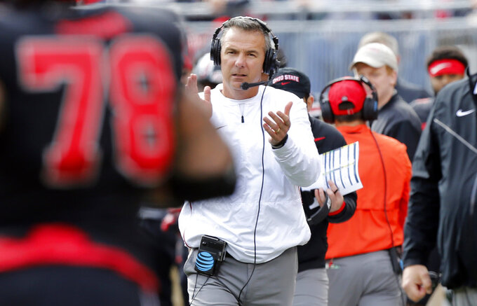 FILE - In this Saturday, Nov. 3, 2018, file photo, Ohio State head coach Urban Meyer watches his team play against Nebraska during an NCAA college football game, in Columbus, Ohio. Meyer hates having to defend the performance of his ninth-ranked Buckeyes, who still have a shot at winning the Big Ten and the national championship heading into their game at Maryland.  (AP Photo/Jay LaPrete, File)