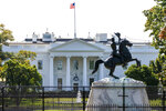A statue of former president Andrew Jackson is seen inside Lafayette Park, which is currently closed to the public, Friday, Oct. 9, 2020, in front of the White House in Washington. (AP Photo/Jacquelyn Martin)