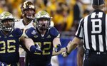 Georgia Tech linebacker David Curry (32) disputes a call on teammate defensive back Malik Rivera (36) during the first half of the Quick Lane Bowl NCAA college football game against Minnesota, Wednesday, Dec. 26, 2018, in Detroit. (AP Photo/Carlos Osorio)