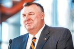 Incoming Illinois football coach Bret Bielema speaks at a news conference at Smith Football Center in Champaign, Ill. Bielema said Monday, Dec. 21, 2020, he hopes to have a coaching staff in place by early January. 2021, and is already concentrating on homegrown recruiting. Bielema, a native of Prophetstown, Ill., replaces Lovie Smith, who went 17-39 overall in his five-year tenure and posted a 10-33 Big Ten record. Bielema's initial contract is for six years beginning with an annual salary of $4.2 million. (Michael Glasgow/University of Illinois Athletics via AP)
