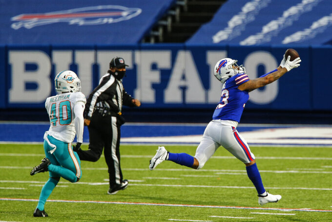Buffalo Bills wide receiver Gabriel Davis (13) catches a pass before running in a touchdown against Miami Dolphins defensive back Nik Needham (40) in the second half of an NFL football game, Sunday, Jan. 3, 2021, in Orchard Park, N.Y. (AP Photo/John Munson)