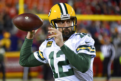 Green Bay Packers quarterback Aaron Rodgers (12) warms up before an NFL football game against the Kansas City Chiefs in Kansas City, Mo., Sunday, Oct. 27, 2019. (AP Photo/Ed Zurga)