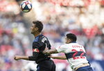 San Jose Earthquakes' Chris Wondolowski, left, gets his head on the ball in front of Vancouver Whitecaps' Erik Godoy during the first half of an MLS soccer game, Saturday, July 20, 2019 in Vancouver, British Columbia. (Darryl Dyck/The Canadian Press via AP)