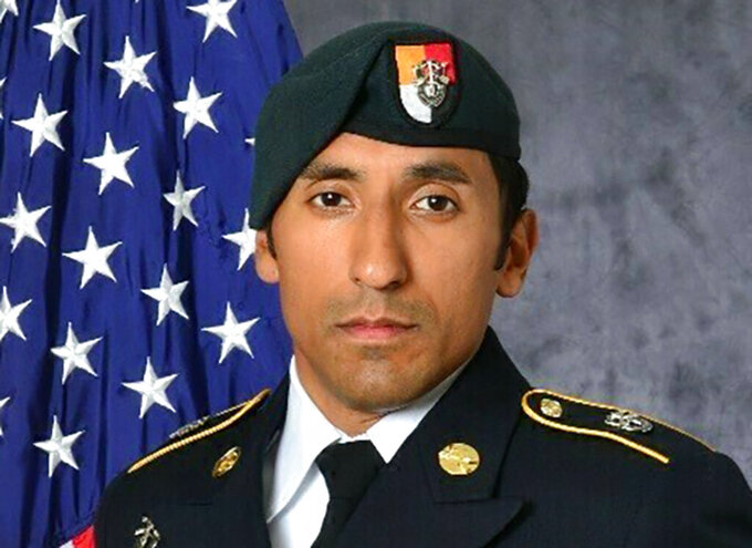 FILE - This undated photo provided by the U.S. Army shows U.S. Army Staff Sgt. Logan Melgar Green Beret, who died from non-combat related injuries in Mali in June 2017. A defense attorney for a U.S. Marine has told jurors that he played a minor role in the hazing of a U.S. Green Beret and should not be found guilty of murder and other crimes in the soldier's death. Marine Lt. Col. Timothy Kuhn spoke Wednesday, June 30, 2021 at a U.S. Navy base in Norfolk, Virginia. He said that Mario Madera-Rodriguez never touched Melgar during the fatal hazing incident until he tried to help revive him. (U.S. Army via AP, File)
