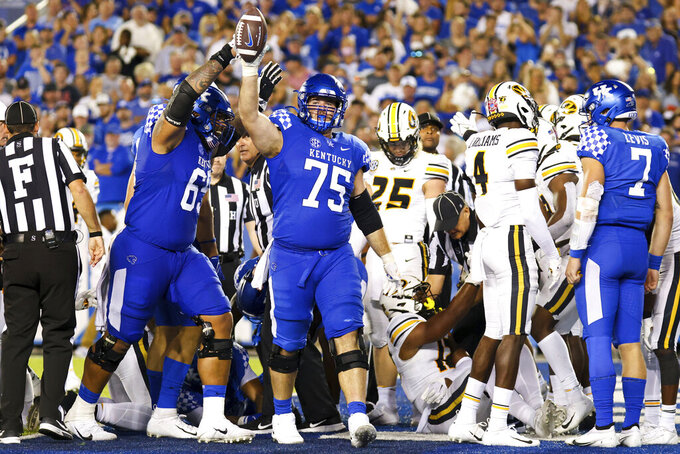 FILE - Kentucky guard Eli Cox (75) celebrates a touchdown during an NCAA college football game against Missouri in Lexington, Ky., in this Saturday, Sept. 11, 2021, file photo. Cox was selected to The Associated Press Midseason All-America team, announced Tuesday, Oct. 19, 2021. (AP Photo/Michael Clubb, File)