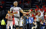 Mississippi guard Devontae Shuler (2) plays an air guitar after making a 3-pointer during the second half of the team's NCAA college basketball game against Auburn, Wednesday, Jan. 9, 2019 in Oxford, Miss. Mississippi won 82-67. (AP Photo/Rogelio V. Solis)