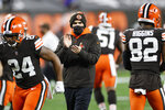 Cleveland Browns head coach Kevin Stefanski keeps watch before an NFL football game against the Baltimore Ravens, Monday, Dec. 14, 2020, in Cleveland. After days of positive COVID-19 tests, disruptions and delays, the Browns found some normalcy and got to re-open their facility on Friday, Jan. 1, 2021, to resume getting ready to play the Pittsburgh Steelers and possibly end a postseason drought stretching back to 2002.(AP Photo/Ron Schwane)