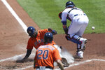 Houston Astros Yordan Alvarez, center, slides across the plate to score  during the third inning of a baseball game against the Toronto Blue Jays in Buffalo, N.Y., Sunday, June 6, 2021. (AP Photo/Joshua Bessex)