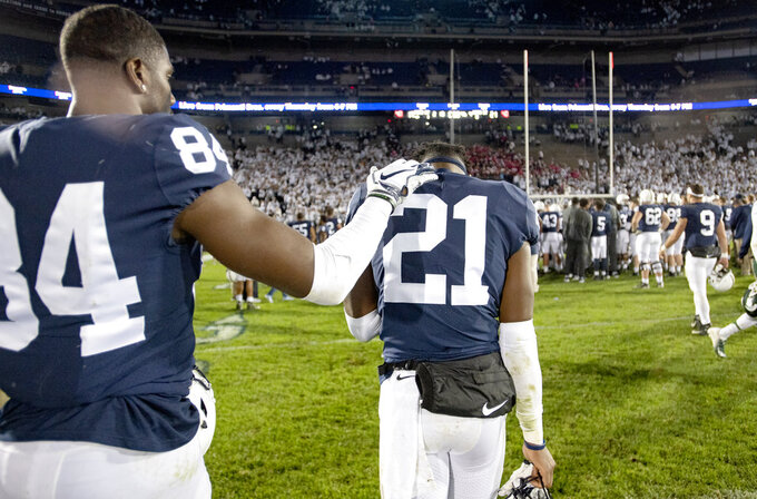 Penn State Juwan Johnson (84) pats cornerback Amani Oruwariye after a loss to Michigan State in an NCAA college football game Saturday, Oct. 13, 2018, in State College, Pa. (Abby Drey/Centre Daily Times via AP)