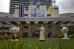 In this Wednesday, Nov. 13, 2019, photo, a billboard and a statue of Pope Francis marking his visit to Thailand is displayed at the Saint Louis hospital in Bangkok, Thailand. Pope Francis on Wednesday will arrive in Thailand for the first visit to the Southeast Asian nation by the head of the Roman Catholic Church since John Paul II in 1984. His private meetings will include an audience with 40 sick and disabled people at St. Louis Hospital. (AP Photo/Gemunu Amarasinghe)