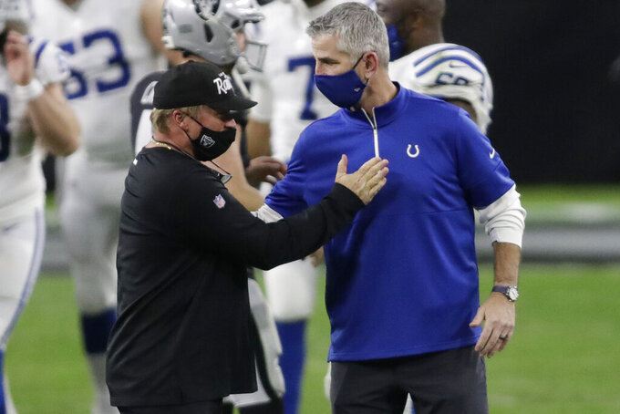 Las Vegas Raiders head coach Jon Gruden, left, greets Indianapolis Colts head coach Frank Reich after an NFL football game, Sunday, Dec. 13, 2020, in Las Vegas. (AP Photo/Isaac Brekken)