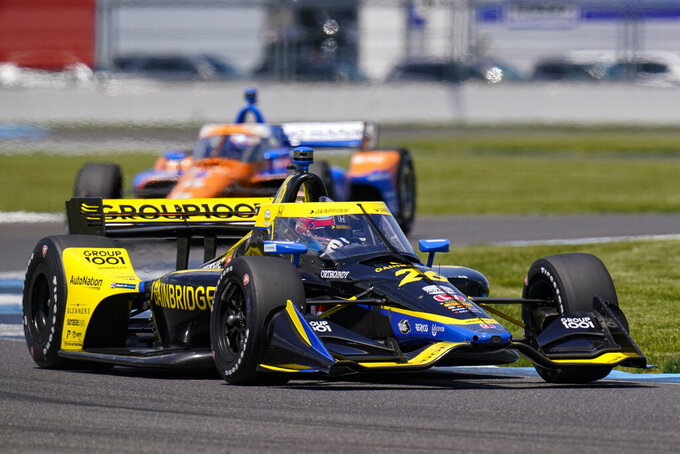 Colton Herta drives through a turn during practice for the IndyCar auto race at Indianapolis Motor Speedway in Indianapolis, Friday, May 14, 2021. (AP Photo/Michael Conroy)