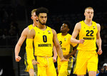 Marquette guard Markus Howard (0) reacts with teammates after scoring a three-point basket against DePaul during the first half of an NCAA college basketball game on Tuesday, Feb. 12, 2019. in Chicago, Ill. (AP Photo/Matt Marton)