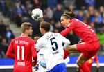 Leipzig's Yussuf Poulsen, right, Timo Werner, left, and and Berlin's Niklas Stark, center, challenge for the ball during the Bundesliga soccer match between Hertha BSC Berlin and RB Leipzig in Berlin, Germany, Saturday, Nov. 9, 2019. (Soeren Stache/dpa via AP)