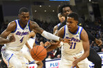 DePaul forward Paul Reed (4), guard Charlie Moore (11) and Northwestern forward Jared Jones, back, go for a loose ball during the first half of an NCAA college basketball game, Saturday, Dec. 21, 2019, in Chicago. (AP Photo/David Banks)