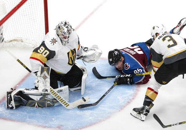 Colorado Avalanche's Mikko Rantanen (96) tries to get the puck past Vegas Golden Knights goalie Robin Lehner (90) during the third period of an NHL Stanley Cup qualifying round game in Edmonton, Alberta, Saturday, Aug. 8, 2020. (Jason Franson/The Canadian Press via AP)