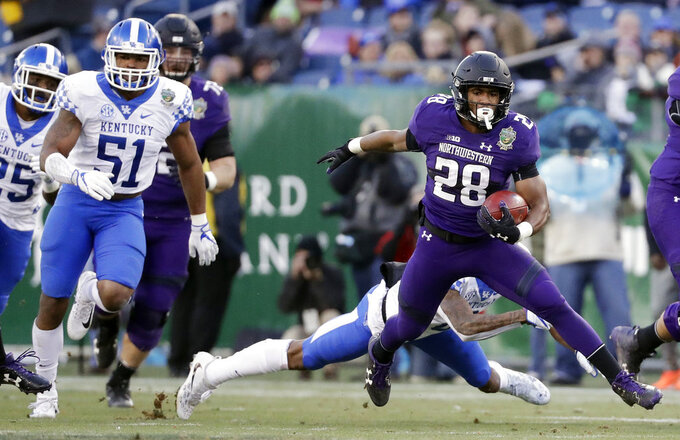 FILE - In this Dec. 29, 2017, file photo, Northwestern running back Jeremy Larkin (28) carries the ball against Kentucky in the first half of the Music City Bowl NCAA college football game in Nashville, Tenn. Larkin ran for 503 yards as a freshman--a career-high 112 against Kentucky--and figures to play a bigger role this season. (AP Photo/Mark Humphrey, File)