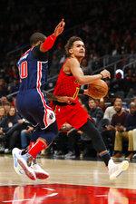 Atlanta Hawks guard Trae Young (11) battles against Washington Wizards guard Gary Payton II (20) during the first half of an NBA basketball game on Sunday, Jan. 26, 2020, in Atlanta. (AP Photo/Todd Kirkland)