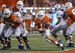 Texas' Sam Ehlinger (11) runs for a long gain against Kansas during the first half of an NCAA college football game in Austin, Texas, Saturday, Oct. 19, 2019. (AP Photo/Chuck Burton)