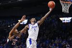 Tulsa forward Martins Igbanu (1) reaches for the ball in front of Connecticut center Josh Carlton (25) during the second half of an NCAA college basketball game in Tulsa, Okla., Thursday, Feb. 6, 2020. (AP Photo/Sue Ogrocki)