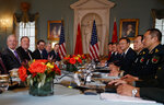 Secretary of Defense Jim Mattis, left, Secretary of State Mike Pompeo, second from left, Chinese Politburo Member Yang Jiechi, third from right, and Chinese State Councilor and Defense Minister General Wei Fenghe, second from right, meet at the State Department in Washington, Friday, Nov. 9, 2018. (AP Photo/Carolyn Kaster)