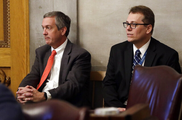 "FILE - In this April 15, 2019, file photo, Tennessee Secretary of State Tre Hargett, left, attends a House session, in Nashville, Tenn. Hargett, who had previously argued the original 2019 voter registration law would bolster election security, is submitting a separate bill in 2020 that will criminalize ""intentional dissemination of misinformation"" surrounding the qualifications to vote, voter registration requirements, voter eligibility and polling dates, times and locations. (AP Photo/Mark Humphrey, File)"