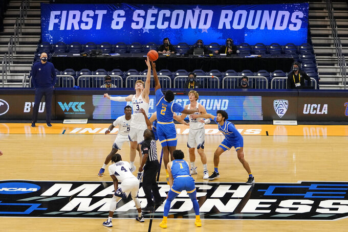BYU forward Matt Haarms (3) goes up for the tipoff with UCLA forward Cody Riley (2) during the first half of a first-round game in the NCAA college basketball tournament at Hinkle Fieldhouse in Indianapolis, Saturday, March 20, 2021. (AP Photo/AJ Mast)