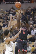 Georgia's Anthony Edwards (5) shoots over Missouri's Mark Smith during the first half of an NCAA college basketball game Tuesday, Jan. 28, 2020, in Columbia, Mo. (AP Photo/Jeff Roberson)