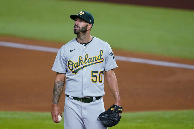 Oakland Athletics' Mike Fiers pauses on the mound as he works against the Texas Rangers during the fourth inning of a baseball game in Arlington, Texas, Wednesday Aug. 26, 2020. (AP Photo/Tony Gutierrez)