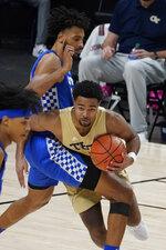 Georgia Tech guard Kyle Sturdivant (1) works to get around Kentucky forward Olivier Sarr, top, during the second half of an NCAA college basketball game Sunday, Dec. 6, 2020, in Atlanta. (AP Photo/John Bazemore)