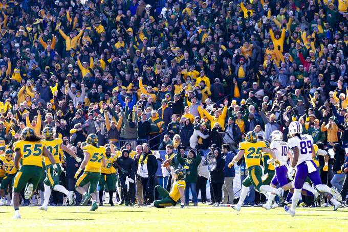 FILE - In this Jan. 11, 2020, file photo, North Dakota State safety James Hendricks (6) slides on the field after intercepting a pass from James Madison quarterback Ben DiNucci during the the second half of the FCS championship NCAA college football game in Frisco, Texas. As the college football season ramps up in three major conferences and among other programs scattered across the country, there will be a void at the Football Championship Subdivision level -- very few games and no scheduled playoffs. (AP Photo/Sam Hodde, File)