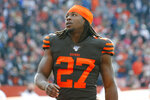 FILE - In this Dec. 8, 2019, file photo, Cleveland Browns running back Kareem Hunt (27) stands on the field before an NFL football game against the Cincinnati Bengals, in Cleveland. Scared he jeopardized his NFL career when police found a small amount of marijuana in his car during a traffic stop, Hunt, who served an eight-game league suspension last season for physical altercations while with Kansas City, said Monday, June 22, 2020, that he's grateful the Browns have stood by him.(AP Photo/Ron Schwane, File)