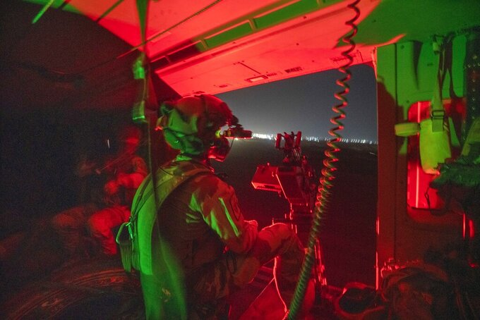 French Barkhane force helicopter lands at its base in Gao, Mali, Monday June 7, 2021, following a night mission.  France suspended joint military operations with Malian forces after the junta led by Col. Assimi Goita retook control of Mali's transitional government May 24 2021, French President Emmanuel Macron announced at a press conference Thursday June 10, 2021 That operation Barkhane would end and be replaced by support for local partners and counter terrorism. (AP Photo/Jerome Delay)